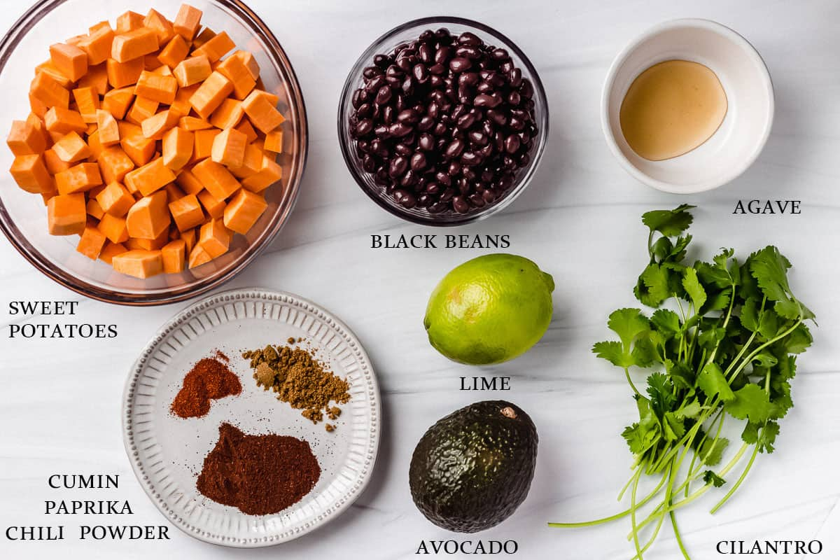 Ingredients to make vegetarian sweet potato black bean tacos with labels on a white background