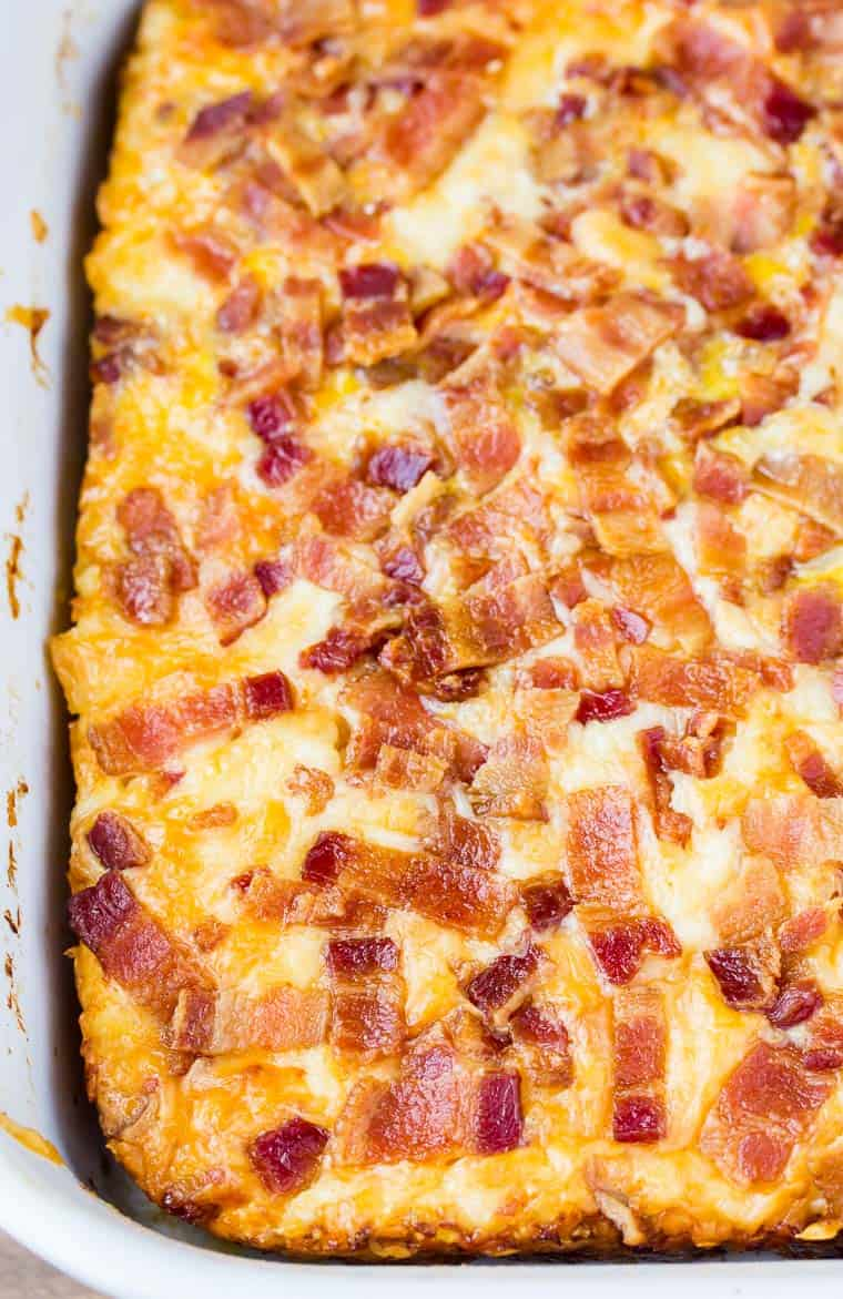A closeup view of half a square baking dish of a baked breakfast casserole.