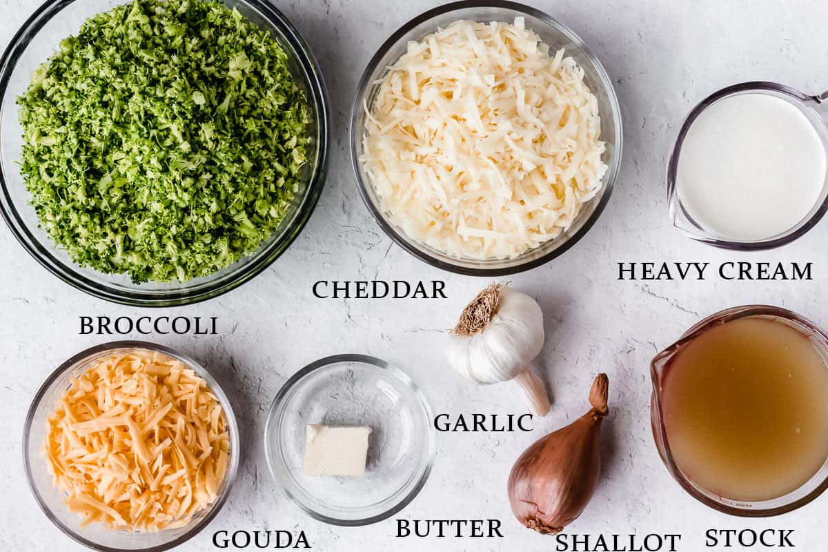 Ingredients needed to make keto broccoli cheese soup on a white background with labels