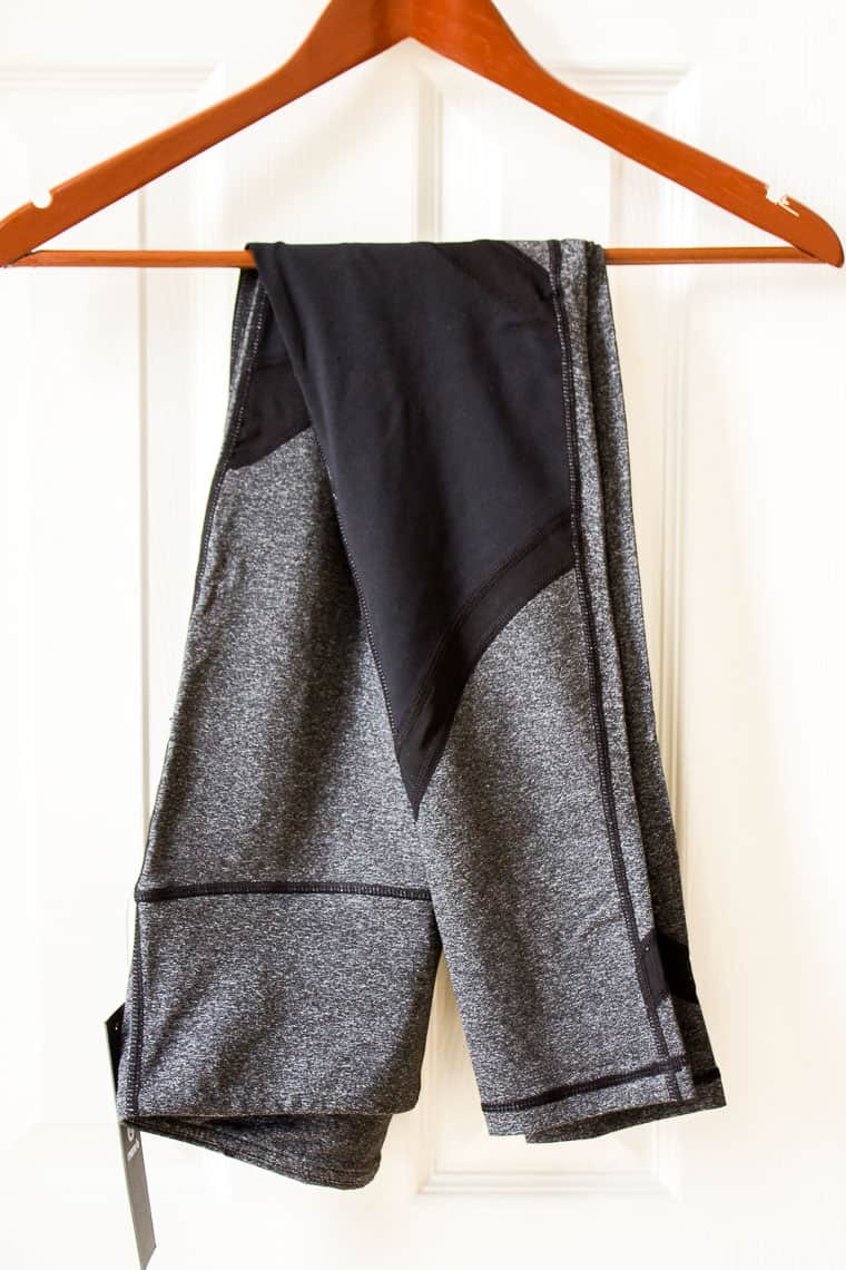 Stitch Fix Mono B Odina Mesh Legging on a wood hanger in front of a white door