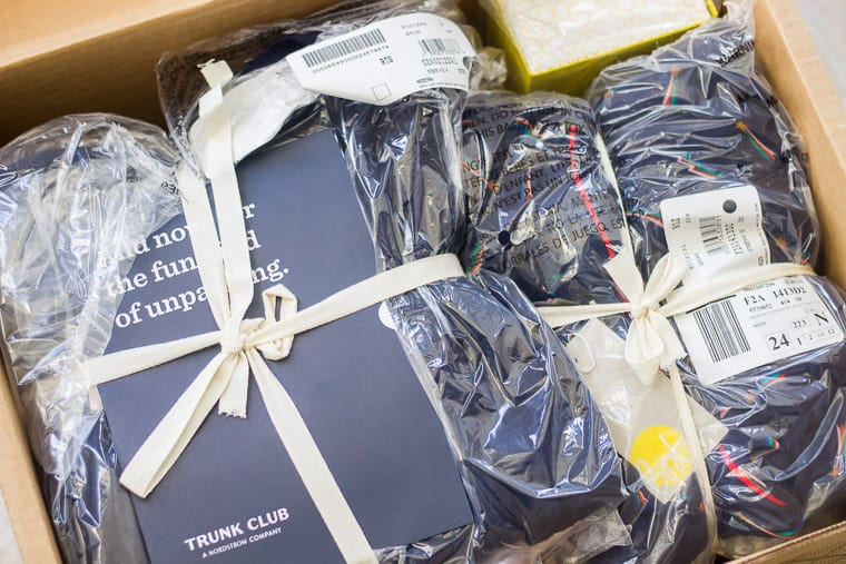 Trunk Club Packaging with clothes in plastic bags with a letter on top