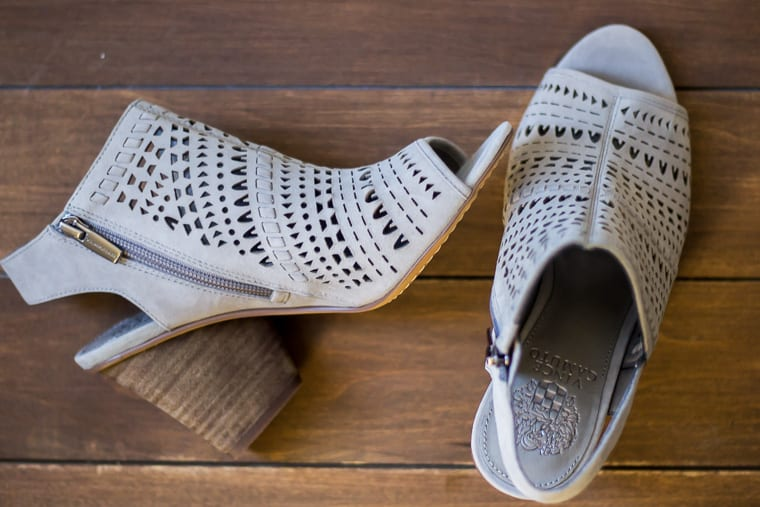Vince Camuto Derechie Perforated Shield Sandal in Storm Grey Suede on a wood backdrop