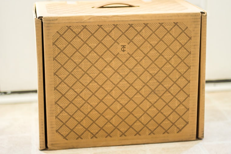 Trunk Club review box on a white floor in front of a white door