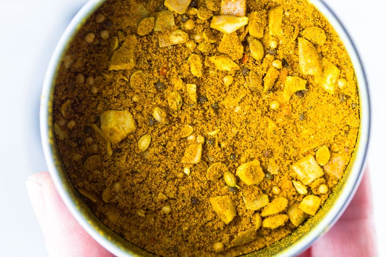 Close up of Vadouvan curry powder in a tin can