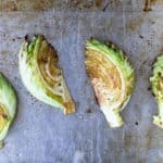 4 Roasted Cabbage Wedges on a baking sheet