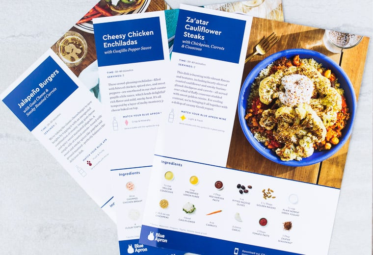 3 Blue Apron recipe cards fanned out on a white background