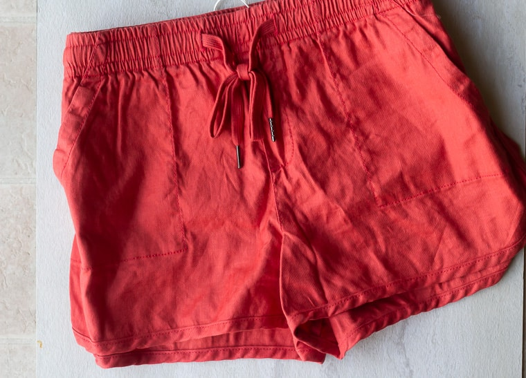 Stitch Fix Level 99 Laird Linen Shorts in coral pink on a white background