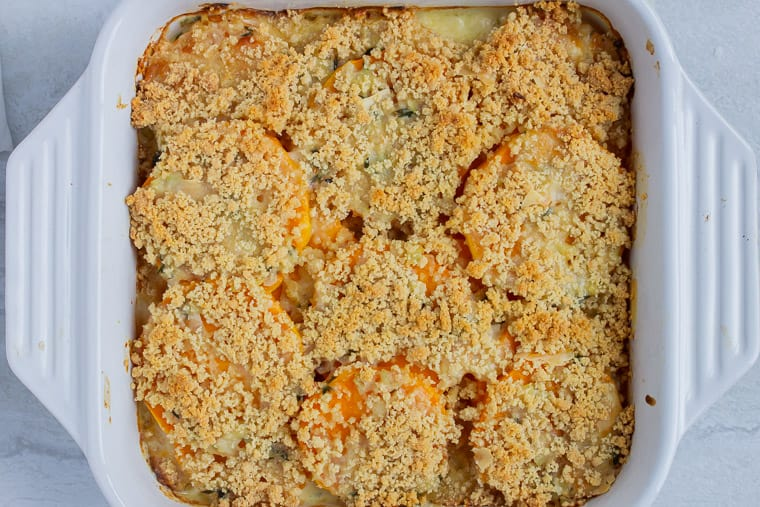 Baked Butternut Squash Gratin in a white, square casserole dish