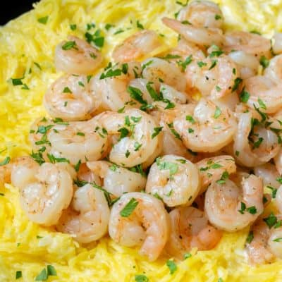 Low Carb Garlic Parmesan Shrimp and Spaghetti Squash in a black skillet close up