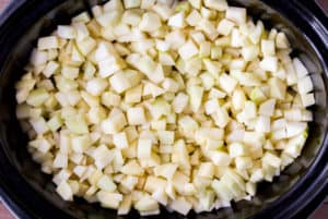 Diced apples in a black slow cooker