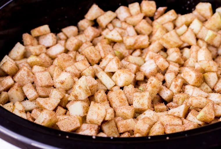 Diced apples and spices in a slow cooker