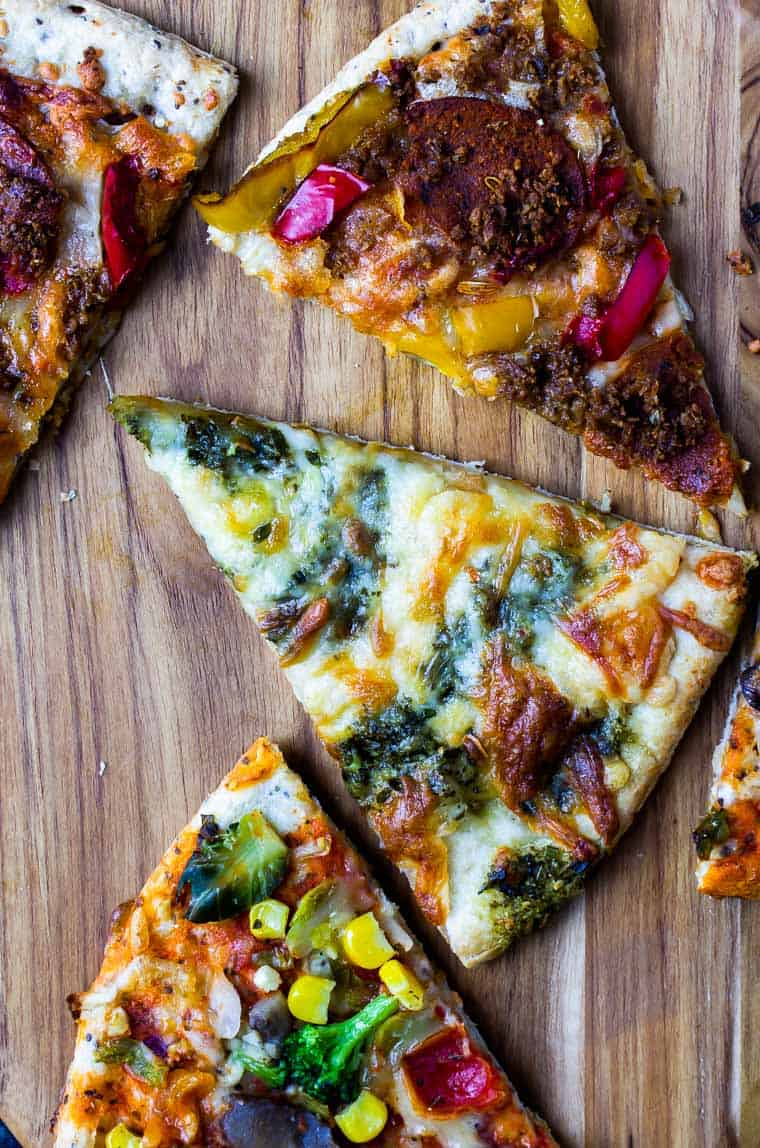 3 Sweet Earth Pizza Review slices on a wood cutting board