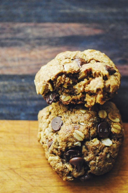 Coconut Chocolate Chip Oatmeal Cookies stacked on each other over a wood table