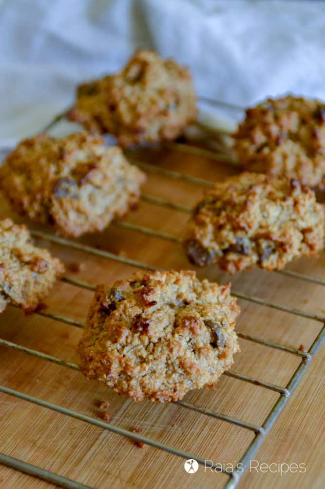 Peanut Butter Coconut Cookies on a cooling rack over a wood table