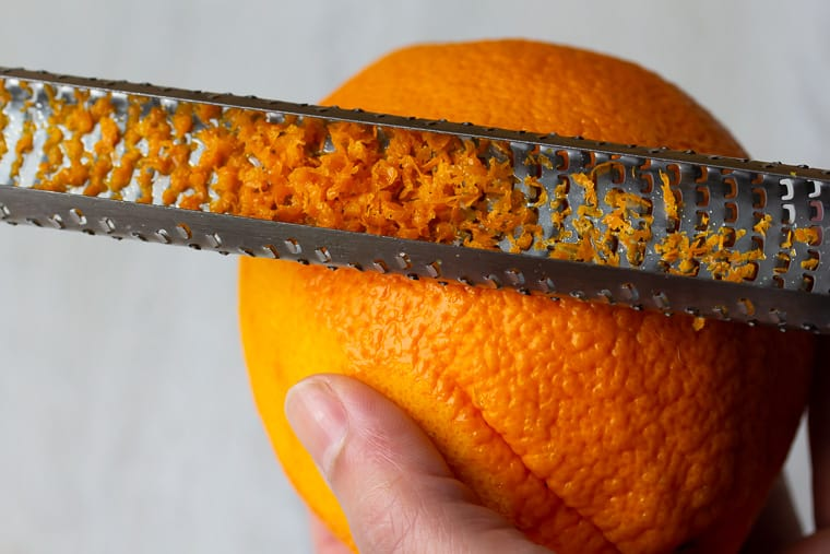 Close up of an orange being zested