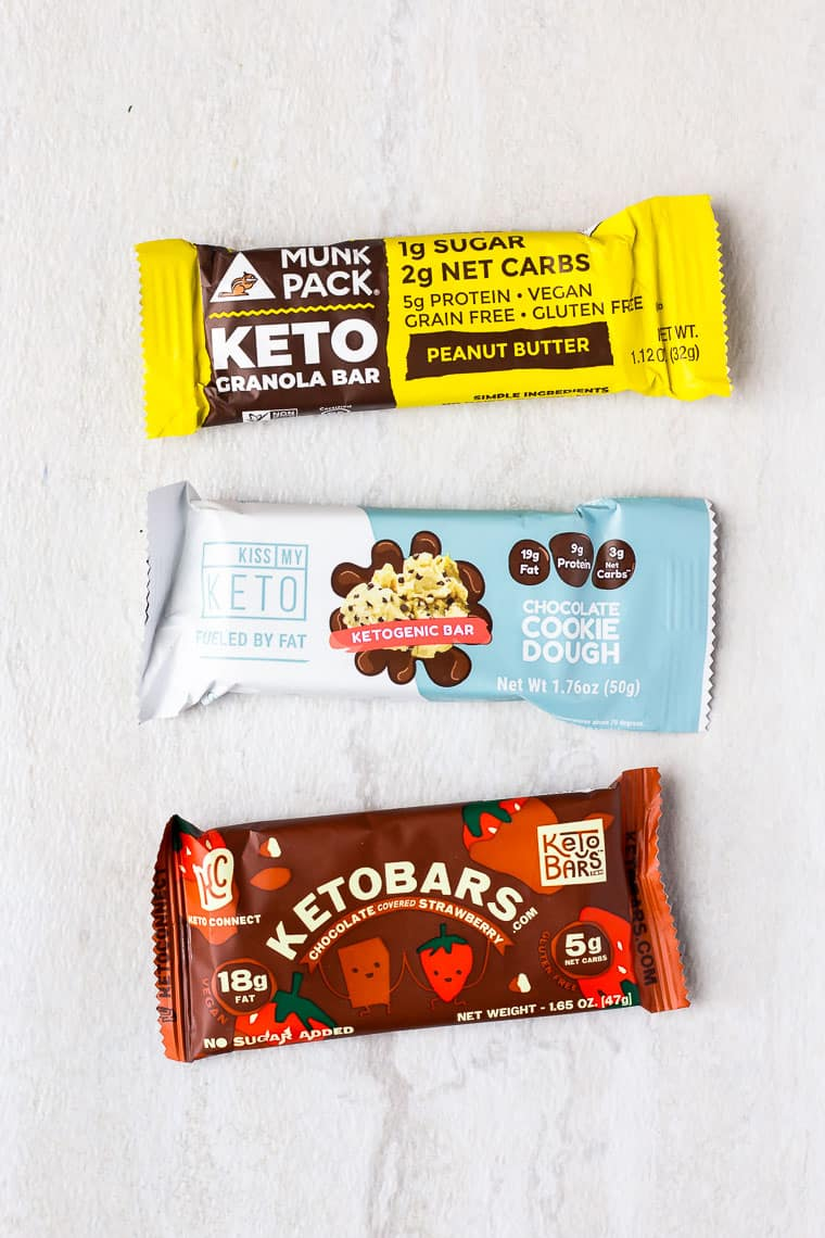3 keto granola bars on a white background