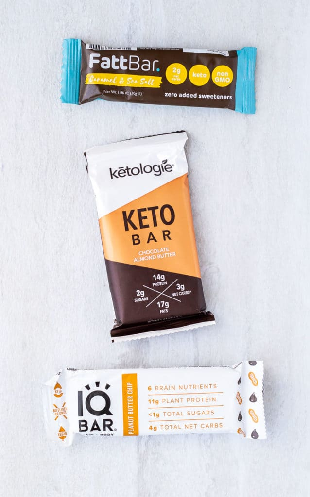 3 different keto bars on a white background