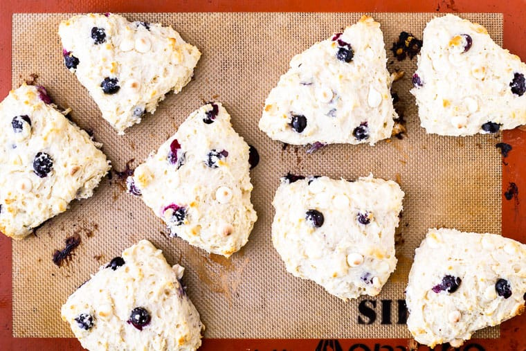 8 baked blueberry scones on a silpat mat