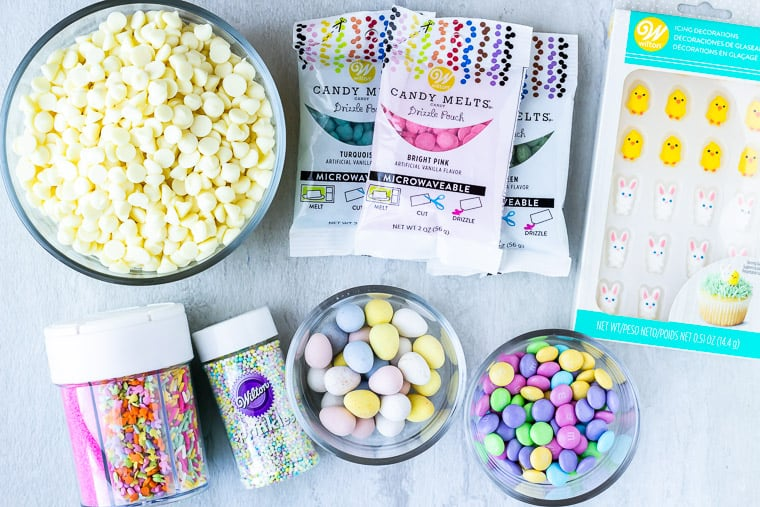 Ingredients needed to make white chocolate easter bark on a white background
