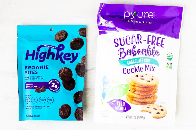 A keto baking mix and brownie bites packages on a white background