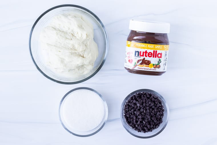 Ingredients needed to make Nutella Babka on a white background