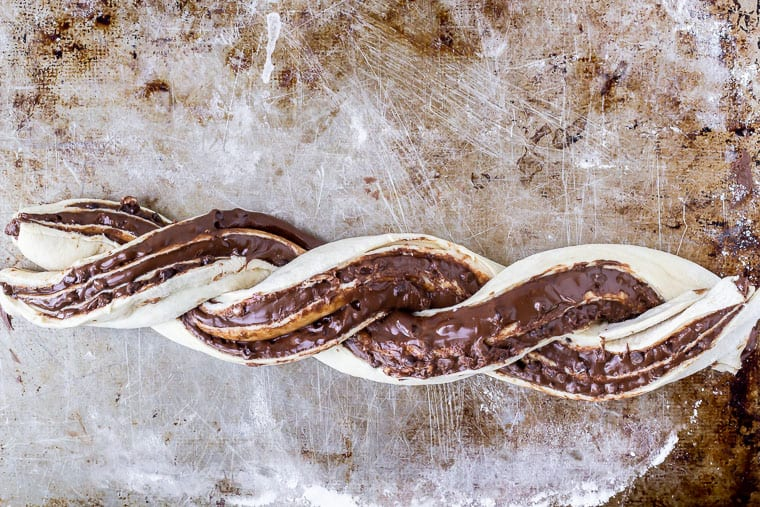 Twisted babka dough on a baking sheet