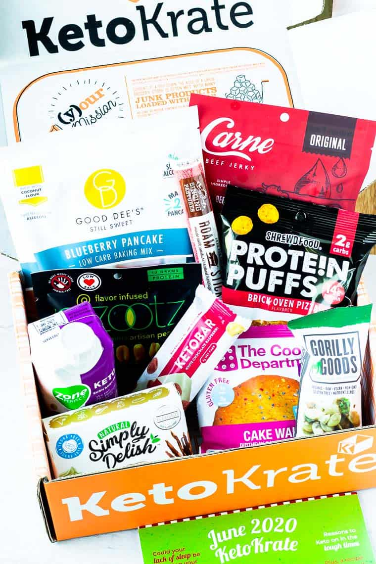 The june keto krate and all the products that come in it displayed inside the box