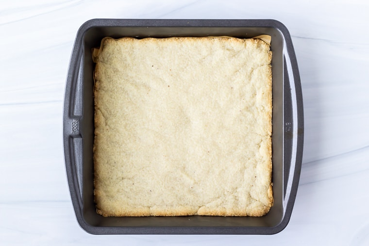 Baked almond flour crust in a square pan