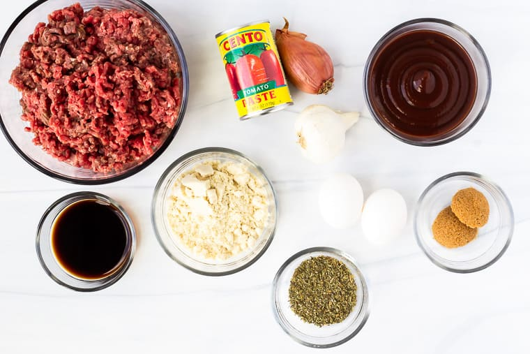 Ingredients to make a keto meatloaf on a white background