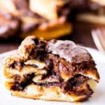 Close up of a slice of Nutella Babka with the rest of the babka blurred in the background