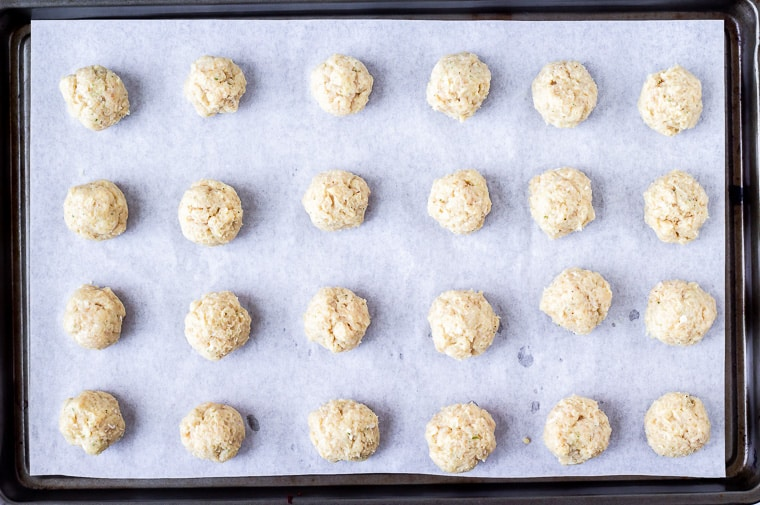 Ranch meatballs on a parchment paper lined baking sheet before baking them