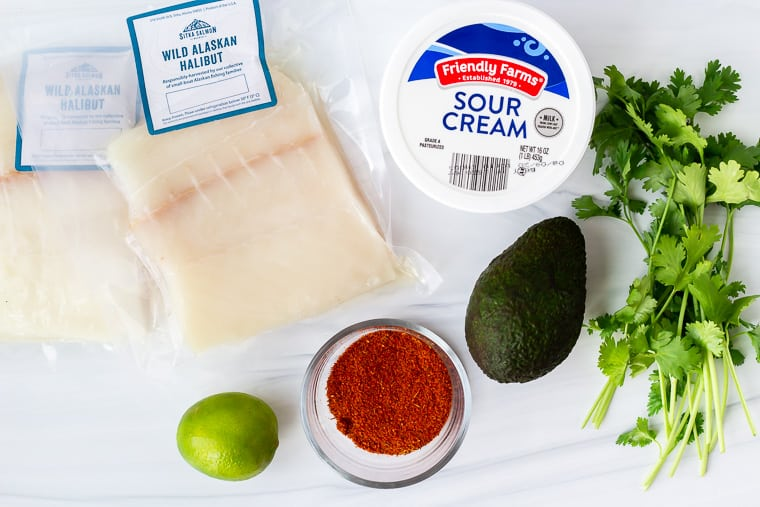 Ingredients to make blackened halibut on a white background