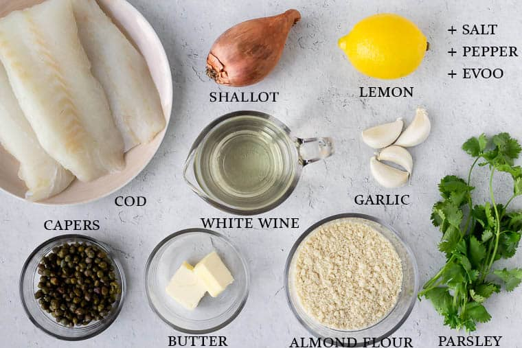 Ingredients needed to make cod piccata labeled on a white background