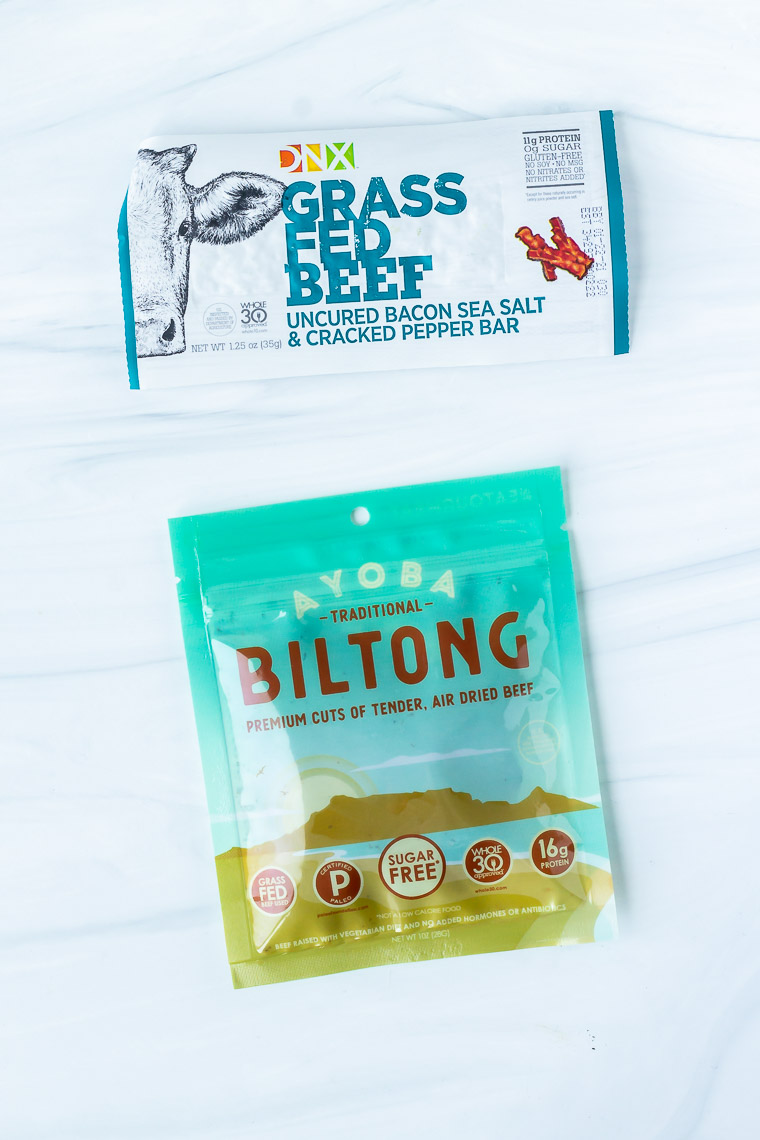 Ayoba biltong and DNX grass fed beef bar on a white background