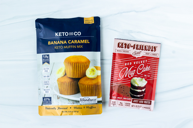 Keto and Co Banana Caramel Muffin Mix and Red Velvet Mug Cake Mix on a white background