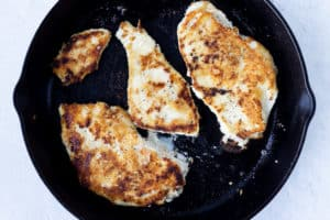 Pan seared chicken breasts in a cast iron pan
