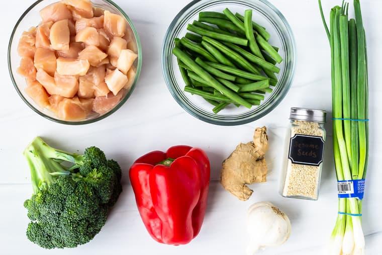 Keto Chicken Stir Fry ingredients on a white background