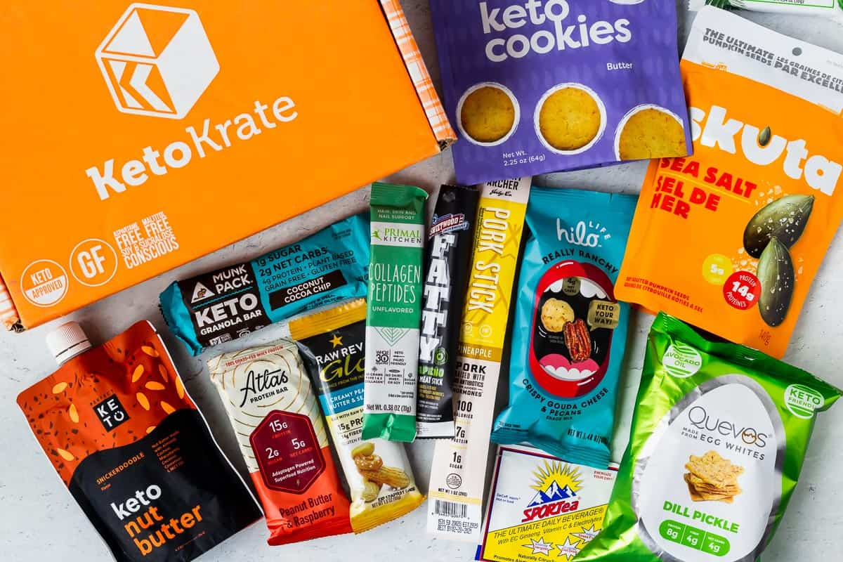 all of the products from the august 2020 keto krate laid out with the box next to them