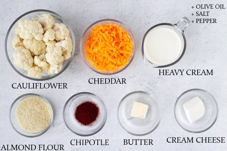 Ingredients to make chipotle cheddar cauliflower on a white background with labels