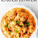 Overhead of chipotle cheddar cauliflower with text overlay