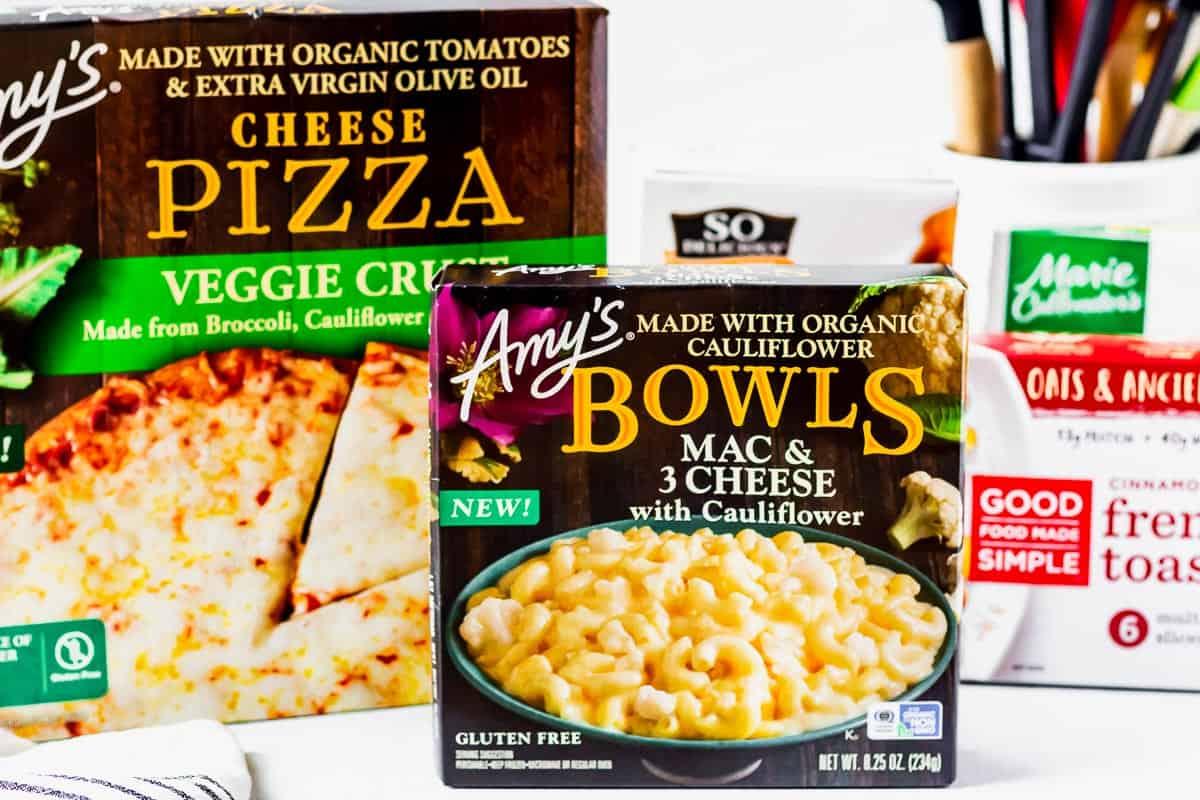 Amy's bowl and pizza frozen meals with other frozen meals in the background