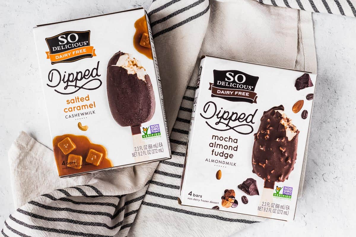 2 boxes of so delicious ice cream bars on a striped towel