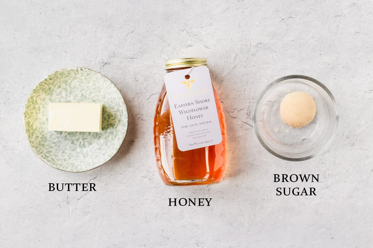 Ingredients to make brown sugar honey butter on a white background with labels