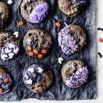 Halloween cookies laid out on black tissue paper
