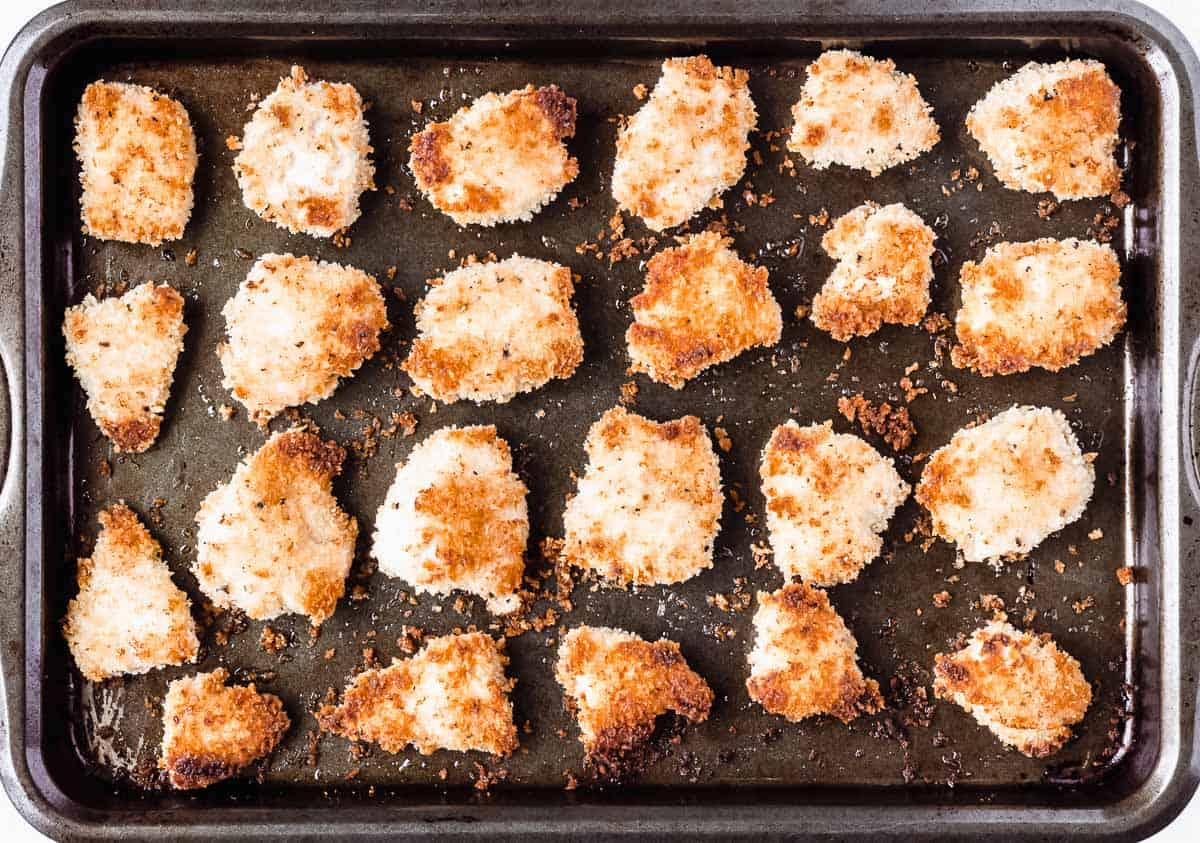 Homemade baked chicken nuggets on a baking sheet