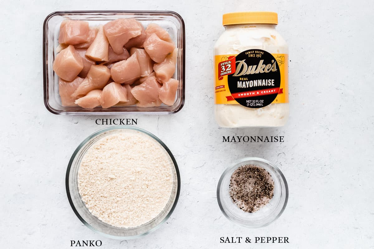 Ingredients to make mayonnaise chicken nuggets on a white background with labels