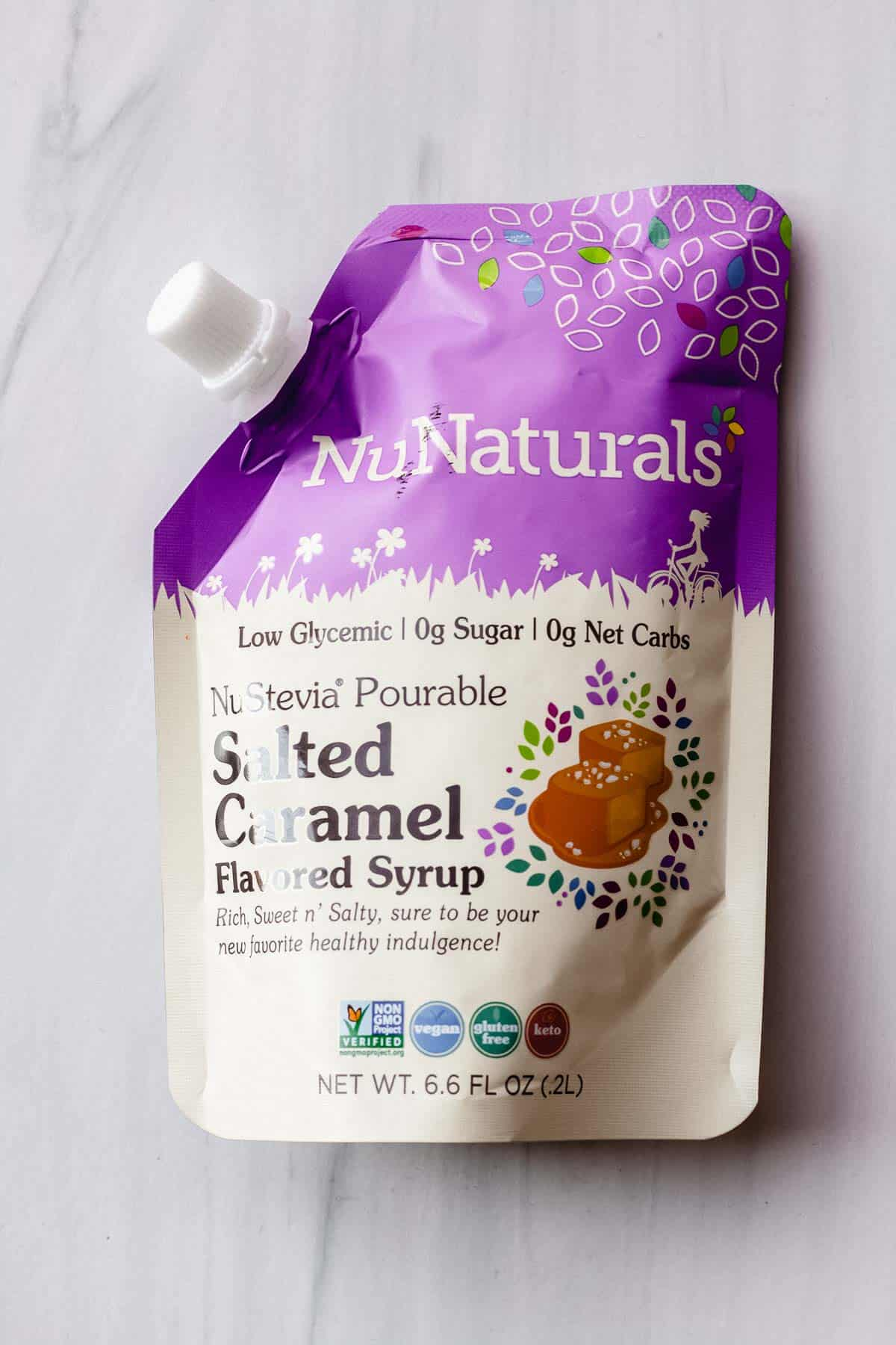 NuNaturals Salted Caramel syrup on a white background