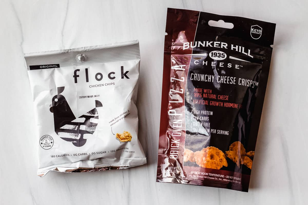 Flock chicken chips and bunker hill cheese chips packages on a white background