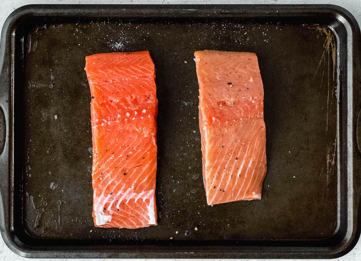 2 salmon filets on a baking sheet