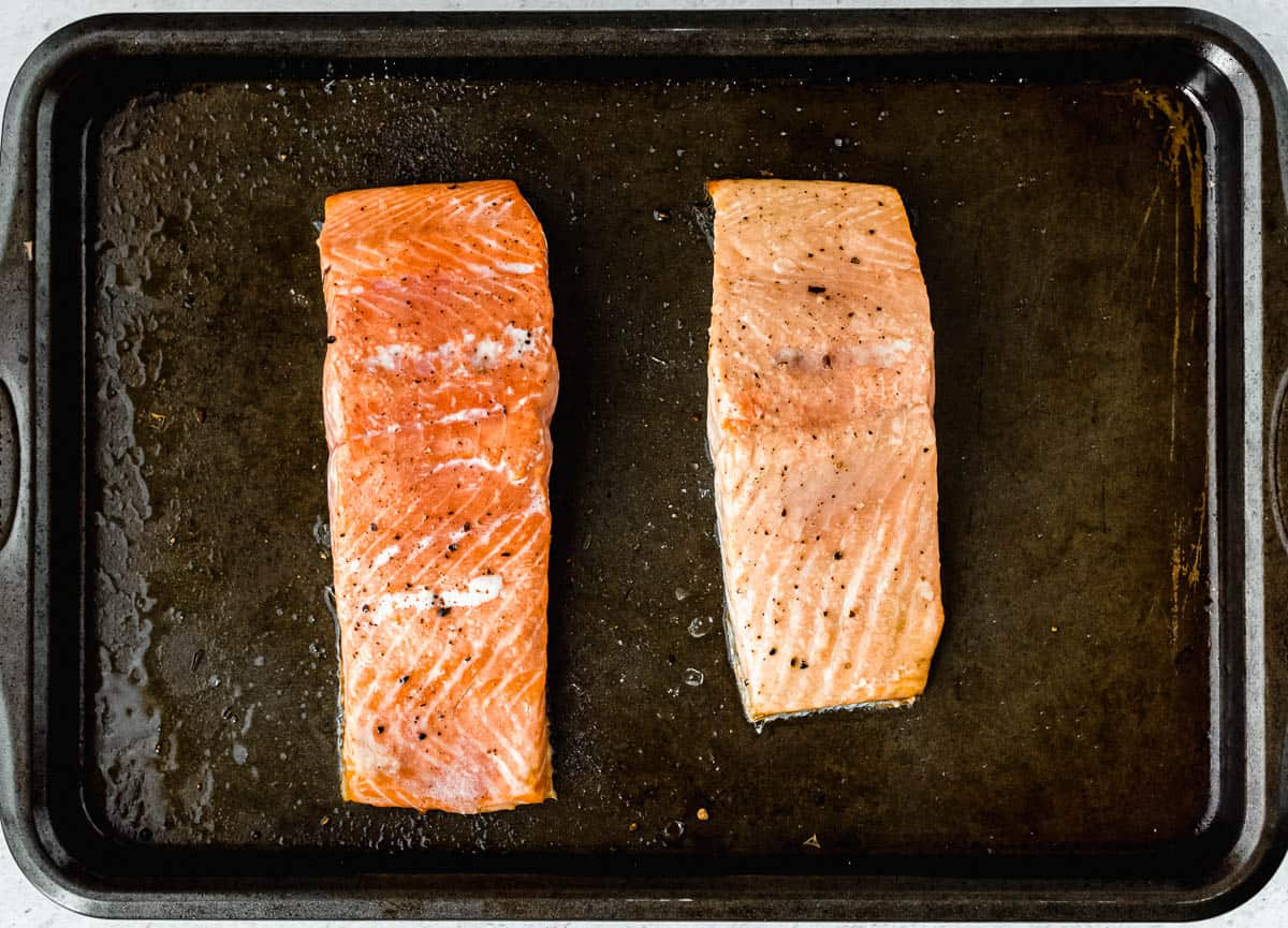 2 filets of baked salmon on a baking sheet